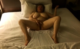 stacked-mature-lady-indulges-in-intense-fingering-on-the-bed
