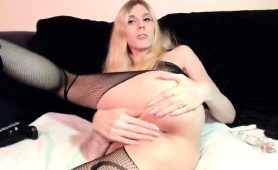 striking-blonde-shemale-in-stockings-exposes-her-sweet-ass