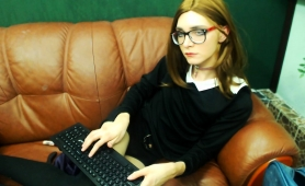 nerdy-young-shemale-in-uniform-pleases-herself-on-the-couch
