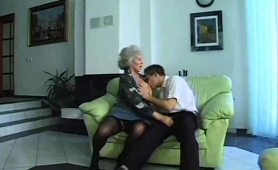 big-breasted-blonde-granny-in-stockings-loves-young-meat