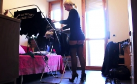 Ravishing Blonde Cougar In Stockings Flaunts Her Sexy Legs