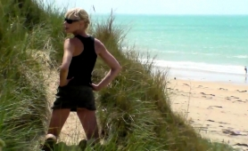 Slender Blonde Milf Gives A Wonderful Handjob On The Beach