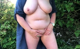 voluptuous-mature-lady-fucks-herself-with-a-sex-toy-outside