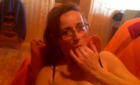 horny-mature-wife-spreads-her-legs-and-fists-her-aching-cunt