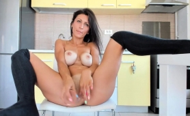 enticing-webcam-milf-with-big-hooters-pleases-her-fiery-cunt
