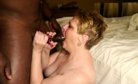 buxom-mature-blonde-milks-a-big-black-shaft-with-her-mouth