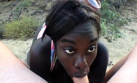 curvy-black-beauty-sucks-and-fucks-a-white-cock-on-the-beach