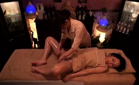 beautiful-asian-babe-is-made-to-cum-by-a-lesbian-masseuse