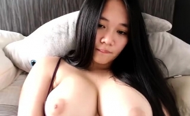 big-breasted-asian-bombshell-masturbates-on-the-webcam