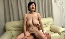 Buxom Japanese Housewife Has A Meat Rod Pleasing Her Cunt